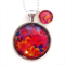 PENDANT NECKLACE WITH CHARM- Abundance of blooms