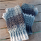 Crocheted fingerless mitts.  pure wool in a mix of greys.