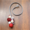 Cherry Frost resin ball necklace on adjustable suede cord