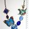 Statement butterfly bird vintage glass blue filigree antiqued brass necklace