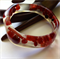 'Lysithea' Red glass beads. Organic Shaped Resin Bangle.