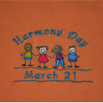 "Embroidered Orange ""HARMONY DAY"" T-Shirt for adults. Sizes S, M, L, XL"