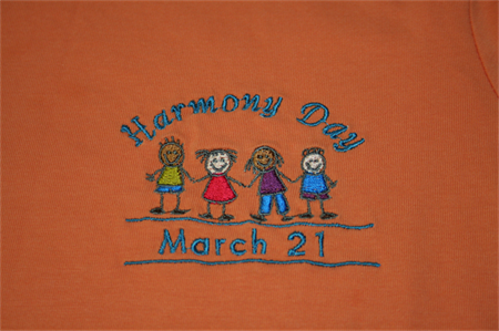 """Embroidered Orange """"HARMONY DAY"""" T-Shirt for adults. Sizes S, M, L, XL"""