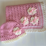 Pretty. Crocheted rug and beanie gift set .