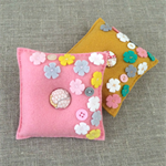 set of 2 felt pincushions in mustard yellow and salmon pink, flowers, gift set