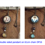 Double sided glass dome art pendant on vintage bronze chain
