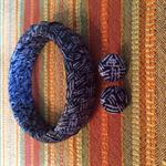 Handmade material wrap bracelet and earring set.