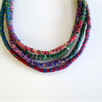 Necklace: Tribal or Primitive Bound Fabric with Thread necklace.