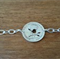 Sterling silver bracelet with florin coin, handcut wren design