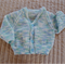 SIZE 6-9 mths - Hand knitted cardigan in white, blue & green : washable, warm,