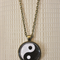 Yin and Yang, antique bronze cabochon necklace with 18 inch chain