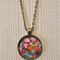 Floral pattern,  antique bronze cabochon necklace with 18 inch chain