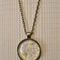 Pastal yellow floral,  antique bronze cabochon necklace with 18 inch chain