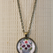 Sugar skull, antique bronze cabochon necklace with 18 inch chain