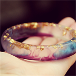 Golden flake resin bangle with metallic blue and deep purple mica