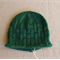 Green knitted beanie size 3-6 months.