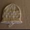 Cream knitted beanie size 0-3 months.