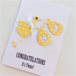 Yellow polka dot stork Congratulations it's Twins with ribbon & pearls baby card