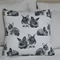 Two bunnies sitting together cushion cover . Double sided.