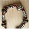 Tiger-iron & brown-marbled jasper, red-dyed howlite & silver. Size: 46.5 cm.