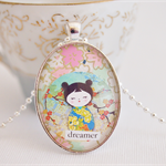 Dreamer Kokeshi Doll collage pendant
