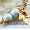 Two Peas In A Pod Gold Necklace Pastel Blue