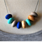 8 bead wooden 'Poly' necklace. Bright aqua, cobalt and pebble