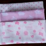 Muslin wrap/swaddle/receiving blanket, pack of three. Baby girl.