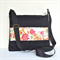 Messenger bag black canvas with bright flowers feature.