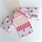 Lavender Heat Pack & Wrap:  beige & red daisies with red diagonal stripe back