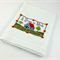 A decorative white waffle weave tea towel with a sentimental embroidered verse.