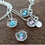 Custom sterling silver bird nest pendant with blue & pink eggs