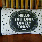 "Cushion -  ""Hello you look lovely"" black print on Essex  linen with black spots"