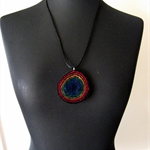 Handfelted rainbow mulberry silk and wool spiral pendant on black satin cord