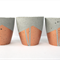 Set of three concrete mini planters/ candle pots, copper