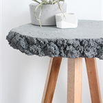 Concrete top rough edged side table, timber legs