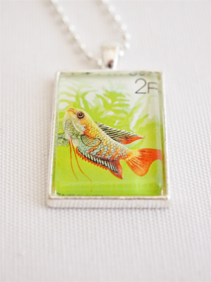 Lucky fish vintage postage stamp necklace starzyia for Fish symboled stamp