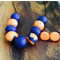 Navy and orange polymer clay necklace and earring set.