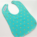 Gold cross on mint bib