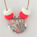 Polymer clay necklace with a touch of art