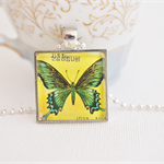 butterfly postage stamp pendant, North Korea 1977