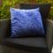 Blue and white confetti print cushion