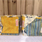 2 Fabric boxes, mustard yellow and blue flowers