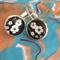 Black and white flower earrings.