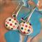 Multi coloured polka dot earrings.