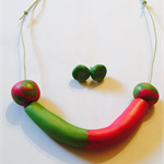 Pink and green necklace and earring set.