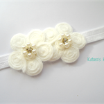 Soft white flower swirl with pearls on a stretch headband