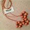 Wooden bead necklace - orange combination beads on adjustable waxed cord