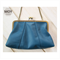 Teal leather handbag with clasp clutch