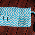 Zippered wristlet clutch, pleated design. Aqua chevron fabric. Made to order.